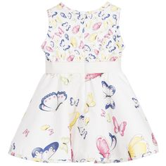 Baby girls white dress by Monnalisa Bebé. Made in cotton, the bodice has a textured feel with a butterfly repeated print and the flared skirt is smooth with larger butterflies. The waistband is elasticated with a scalloped trim and it fastens with a zip at the back.