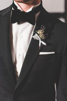 Velvet bow tie, textured white shirt, black jacket, classy boutonniere   Brittani Elizabeth Photography