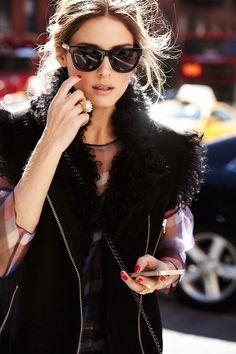 Olivia Palermo // Furry black vest and subtle cateye sunglasses. #classic