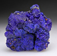 Azurite is a soft, deep blue copper mineral produced by weathering of copper ore deposits. It is also known as Chessylite after the type locality at Chessy-les-Mines near Lyon, France. Cu3(CO3)2(OH)2