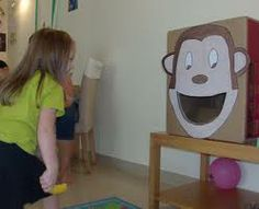 Feed the Monkey Game: tossing banana bean bags into a monkey board/box