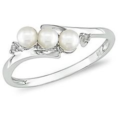 @Overstock - Click here for Ring Sizing ChartRing is crafted of 10-karat white goldRing shimmers with rich cultured freshwater pearls  http://www.overstock.com/Jewelry-Watches/Miadora-10k-White-Gold-FW-Pearl-and-Diamond-Ring-3-mm/3937623/product.html?CID=214117 $127.49