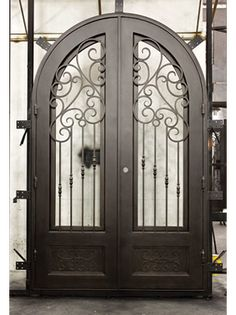 We make custom grand entry doors like this beautiful one made out of wrought iron! Wrought Iron Doors, Iron Gates, Entry Doors, New Homes, Pantry, House Ideas, Beautiful, Design, Home Decor