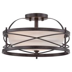 Cast a stylish glow in your favorite spaces with this distinctive semi-flush mount, featuring open x-shaped panels and an etched opal glass shade.