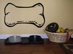 Dog Bone - from www.beautifulwalldecals.com This simple dog bone decal is an adorable addition to your dog's space! Available in large or small sizes, you can customize it to fit anywhere in your home! What a cute idea!