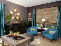 awesome new living room via the Property Brothers, HGTV | warm gray on walls, turquoise accents, antique lit star, unique accent pieces + furniture, I love it all!