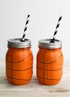 Hand painted basketball mason jars that can be customized to your specific team. Use glass craft paints to make them and follow the instructions to make them scratch resistant and top rack dishwasher safe.