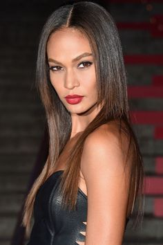 Joan Small's is a true vixen with red lips and ultra straight hair: