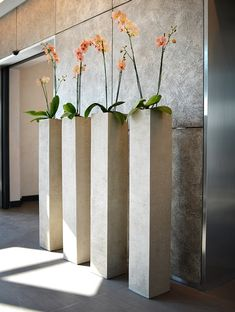 Tall planters can decorate a large space or serve as a focal point for several smaller plants. There are alternate ways to fill your planters. Tall Planters, Indoor Planters, Ceramic Planters, Planter Pots, Orchid Planters, Cement Planters, Concrete Furniture, Concrete Pots, Concrete Crafts