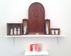 Molly JC - casts of objects which represent parts of her life. The book below the main installation is a beautifully constructed catalogue of her 'museum to self'. Truro College, Display Ideas, Floating Shelves, Drugs, Religion, Presentation, Objects, It Cast, Museum