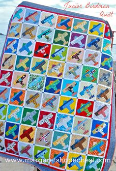 "Junior Birdman Quilt --   Finished Block Size: 8.5 inches  Finished Quilt Size: 90""X 72""  Machine Pieced by Carin Vogelzang   Hand Quilted by Marguerite Petroelje"