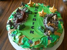 When your son asks for an Army cake, that's what he gets. Double layer cake with multi dyed Wilton whipped icing smeared on to look like camo. Toys from the toybox (washed first) and cookie and cream crumbles. Star and tank candles and his name using Wilton edible decorating paper, pre cut letters.