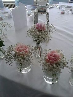 Pretty pink roses mixed in baby breath. Very elegant and simply centerpieces.