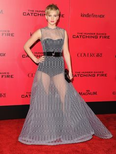 November 18, 2013: Jennifer Lawrence wears a Dior Haute Couture dark grey and light grey knitted evening dress to the Los Angeles premiere of The Hunger Games: Catching Fire.