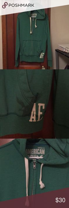 Green zip front hoodie Men's green zip front hoodie. American eagle's vintage fit with drawstring, front pockets and AE graphic logo on bottom left side. Perfect for the upcoming St. Patrick's day holiday! American Eagle Outfitters Shirts Sweatshirts & Hoodies
