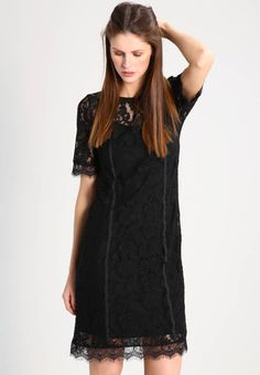 """GUNO - Cocktail dress / Party dress - black. Lining:94% viscose, 6% spandex. Outer fabric material:60% cotton, 40% poly amide. Fastening:button. Total length:39.0 """" (Size S). Fabric:Lace. Details:undergarment. Length:short. Pattern:plain. Fit:small. Neckline:round neck. Our model's height:Ou..."""