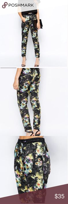 Jovonnista Muse printed Pants Jovonnista Muse printed Pants Super chic. In normal condition waist is 26inches, which can be stretched to 36 inches with elastic band and strap. Wore once Jovonnista Muse  Pants