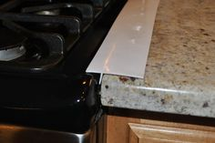 Great way to keep gunk from dripping in to that gap between my stove and counter top. Available in black, white, and clear. #springcleaning
