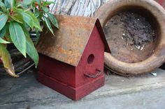 Rustic red birdhouse