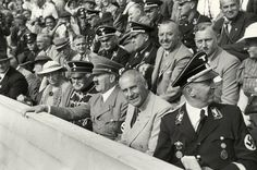 1936 August 15   Berlin Summer Olympics  Hitler and Interior Minister Frick (Hitler's left), August von Mackensen (Hitler's right). 2nd row Viktor Lutze    and making her way to the Fuhrer…  an amorous admirer  All watching the Women's 400m Freestyle Final