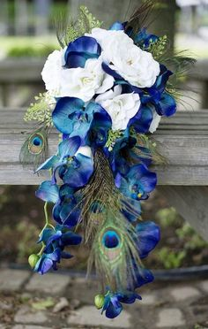 Blue Phalaenopsis Orchids and Peacock Feathers make a stun… DIY Wedding Bouquet. Blue Phalaenopsis Orchids and Peacock Feathers make a stunning cascading bouquet. DIY Bouquet for the budget bride. Bouquet Bleu, Cascade Bouquet, Cascading Bouquets, Feather Bouquet, Blue Orchid Bouquet, Flower Bouquets, Tulip Bouquet, Diy Wedding Bouquet, Diy Wedding Flowers
