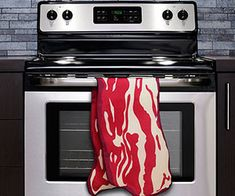 By-pass the doubled-quilted paper towels next time there's a mess in the kitchen and wipe it off with some bacon. The bacon kitchen towel is one long, savory and absorbent slice of bacon you can use for anything from clean ups to drying the dishes. Buy It $4.99 via ThinkGeek.com