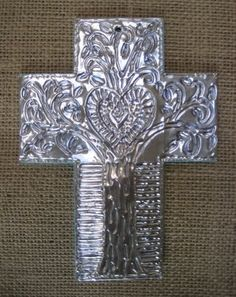 I have seen this image on Pinterest, but this is link to the actual instructions!  Haitian-Inspired Foil Cross | TeachKidsArt