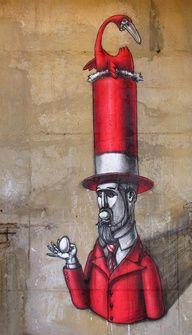 Surreal street art. Red top hat