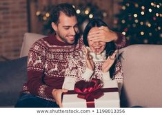 Attractive man hold big white package with red bow sit in cozy living room with illumination garland decorations on pine three close eyes to his brunette lady make surprise First Christmas Photos, Christmas Quotes, Christmas Love, Christmas Pictures, Christmas Abbott, Whoville Christmas, Holiday Celebrations Around The World, Celebration Around The World, Christmas Inflatables