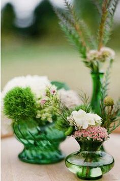Green apothecary jars as centerpieces