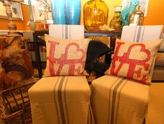 """Hiden:  """"Love"""" pillows on corseted dining chairs"""