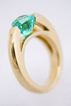 Handcrafted solid 18 carat yellow gold ring with 3.08 carat Paraiba Tourmaline inset. STUNNING