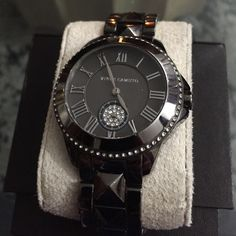 Vince Camuto Crystal Studded Watch Great watch! Dark silver studded band. Elegant sparkle around the bezel. Has a minor scratch on metal by the dial pin. Otherwise in excellent condition. Includes extra links and tags. Box not included. Vince Camuto Accessories Watches
