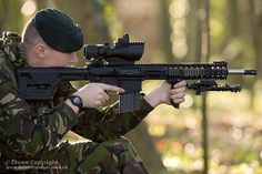 A soldier demonstrates the new L129A1 rifle nicknamed Sharpshooter.    The rifle will improve the long-range firepower available on the front line.