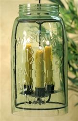From Our Rustic Home Collection:  Made with recycled glass.  Includes the large mason jar with no bottom, the candle holder, and a hook for hanging. Mason Jar measures