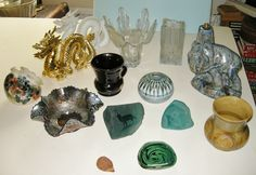L-R; back to front = Gwili salt; Pair of dragons (hubby's going to mount them on wooden blocks to make them into bookends); Ravenhead 'cactus' vase; Walther glass vase; Elephant lamp-base.- possibly Empire Ware; Carnival glass bowl;  Gladstone Museum Pottery mug - based on 19th century design; Briglin Pottery globe-shaped bud vase; Two green glass paperweights made by SIKU Canada; Alvingham vase; New Forest hedgehog; Dunster agateware pin dish