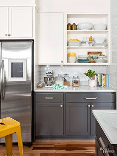 Painting the maple cabinets charcoal and white helped blend the new cabinet by the sink as well as a panel that covers the soffit on the fridge wall. The medley of bright and creamy whites found throughout make for a clean, sunny space worth spending time in.