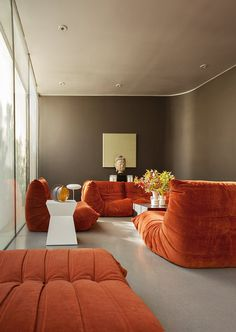 Tim's Urban Desert Light Box House Tour. | This is probably the closest to exactly how I'd love my home to look of any I've ever seen. Orange Togos by Ligne Roset, modern furniture and artwork, vintage and antique rugs...swoon and swoon some more. ♥♥♥