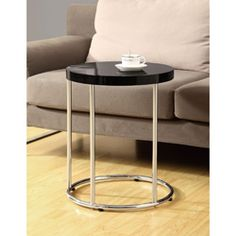 @Overstock - Add a stylish touch to your living space with this versatile, round-black accent table. Sleek, supportive legs with a chrome finish and a glossy black tabletop complete this contemporary table which measures 24 inches high by 18 inches wide and deep.http://www.overstock.com/Home-Garden/Glossy-Black-Chrome-Metal-Accent-Table/6811413/product.html?CID=214117 $77.99
