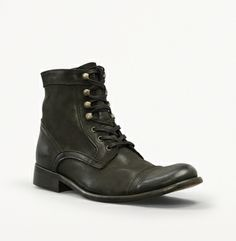 Kenneth Cole Game Place Boot - I tried these on today. The balance is far back on the heel, which made the lack of traction difficult to manage. They look nice, but exercise extreme caution.