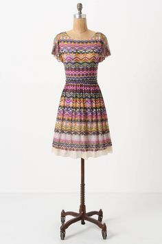 obsessed with this dress -- stretchy material, but with a tulle layer at the bottom and underskirt - anthropologie