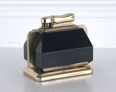 Deliciously Deco! Love this Brass and Black Bakelite Lighter.