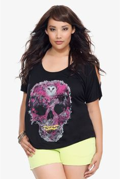 Internet exclusive! Give your look some extra attitude with this cool update to the graphic tee. A purple skull - formed by an owl, flowers, mushrooms and skeletons - colors the front, while a back zipper detail lends sexy edge.