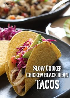 Slow Cooker Chicken Black Bean Tacos - This easy taco recipe requires no pre-cooking, just throw it all in the crock pot and you'll have a delicious weeknight meal.