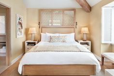 Neutral beach tones create a cozy atmosphere in this bedroom.