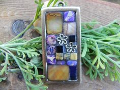 Purple, bronze flowers, caramel and silver shell. stone beads, pendant
