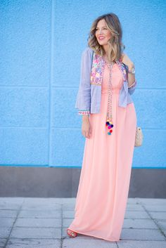 peach maxi dress with pom pom necklace and embroidered jacket