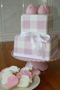Beautiful work! pink and white cake. baby shower, booties.