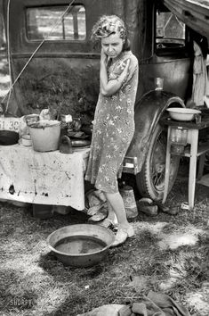 "I just can't stop looking at her face...it says it all. July 1940. Berrien County, Michigan. ""Migrant mother of family from Arkansas in roadside camp of cherry pickers."""