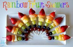 St. Patrick's Day is right around the corner. Get in the spirit of this fun holiday by making these Rainbow Fruit Skewers for your kids, or even with your kids.    A few years back I just made a big platter of fruit shaped into a rainbow, for my